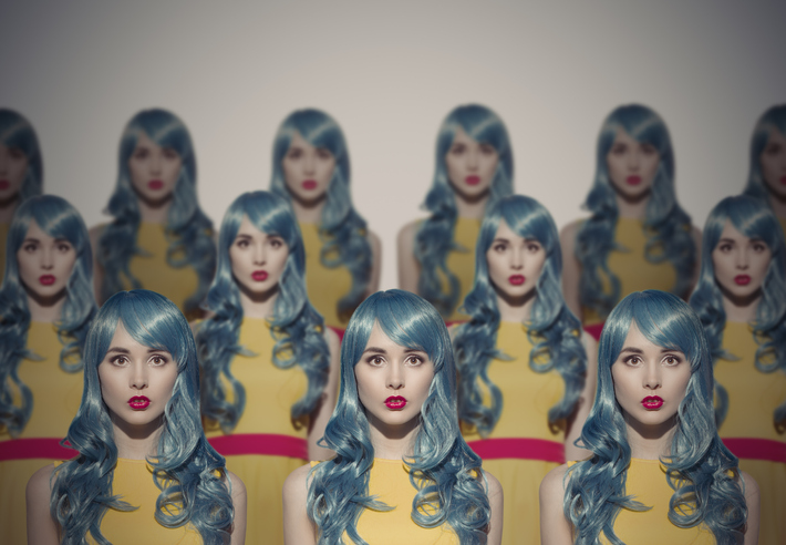 a collection of love dolls with blue hair and red lips
