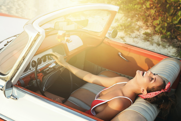 sexy woman read to drive off for her summer holiday